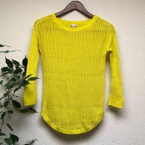 Bright yellow open knit sweater